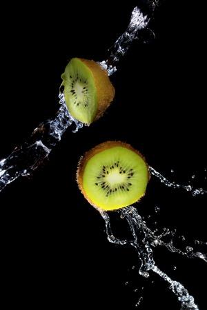 Kiwi slices in water splash Stock fotó