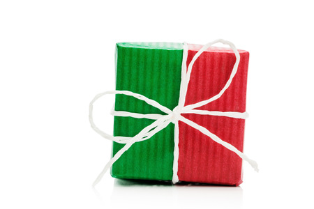 surprise gift: Green and red gif box isolated on white background