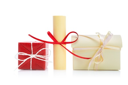 scroll: Gift boxes and paper scroll isolated on white Stock Photo
