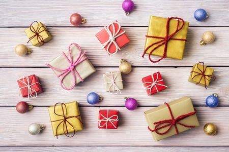 Gift boxes and xmas decoration over wooden background