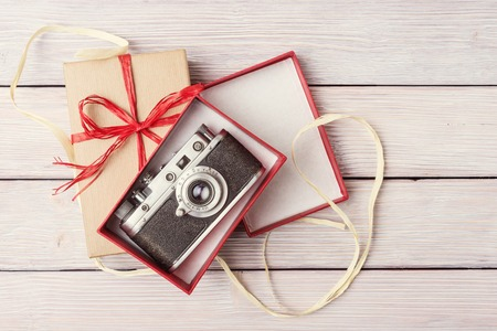 Top view of vintage camera in open gift box Stock Photo