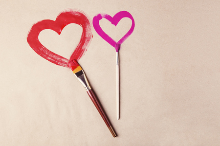 copy sapce: Two hearts painted with brushes on Valentines day celebration Stock Photo