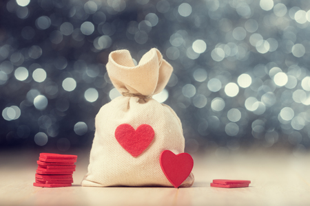 against abstract: Sack of Valentines hearts against abstract background Stock Photo