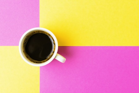 copy sapce: Cup of coffee on multicolored background