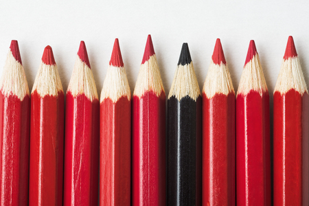 multiple personality: Red pencils and one black pencil, individuality concept Stock Photo