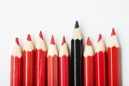 multiple personality: Group of pencils with one black among of red, individuality concept
