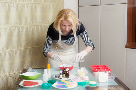 Woman in the process of homemade soap making