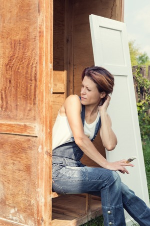 old furniture: Woman is posing outdoors during old furniture renewal