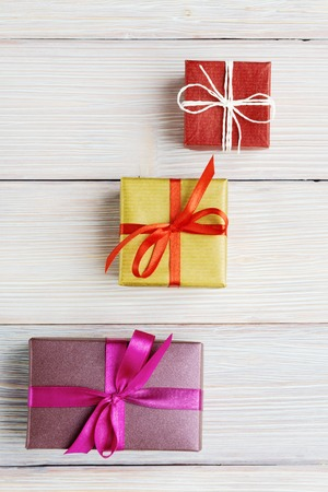 Various gift boxes over white wooden background Stok Fotoğraf