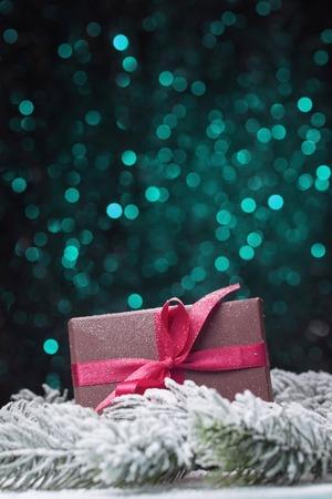 snowbound: Snowbound gift box over green defocused lights