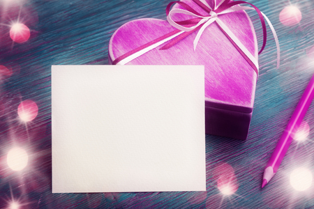Blank paper template with pink pencil and gift box. Valentines day concept Banco de Imagens