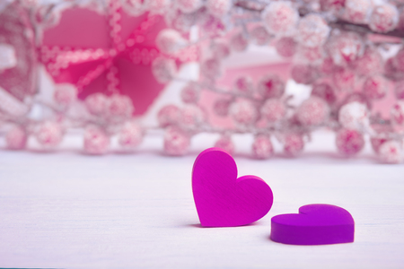 Two violet hearts over defocused hoarfrost berries and gift box Banco de Imagens