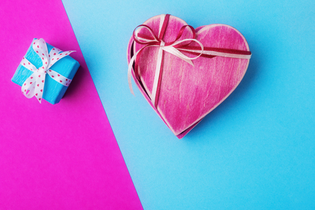 Gift boxes on pink and blue
