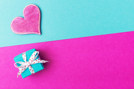 Valentines day decoration over turquoise-pink