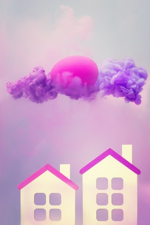 Surreal fantasy with two houses and egg in violet fluid cloud