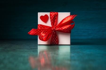 White gift box with red heart and spotted bow Stock fotó