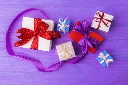 Valentines day concept with various gift boxes on violet wooden background