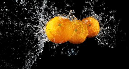 Fresh orangees in water splash on black background Stock fotó