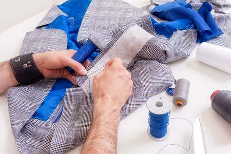 Male tailor hands during suit manufacturing. Small business concept Stok Fotoğraf