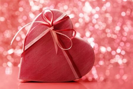 Heart shaped wooden gift box against holiday