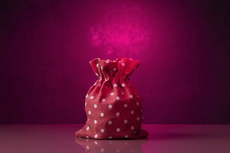 Red spotted sack over pink