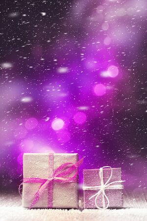 Snow-covered Xmas gift boxes over snowy holiday
