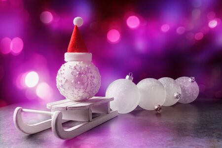 Christmas background with decorative baubles and Santa's sleigh over holiday background