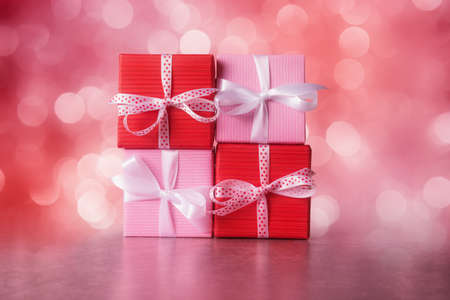 Red and pink gift boxes against defocused lights