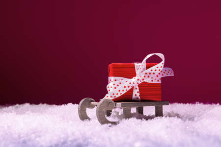 Santa's sleigh with red gift box in snow. Christmas and New Year concept