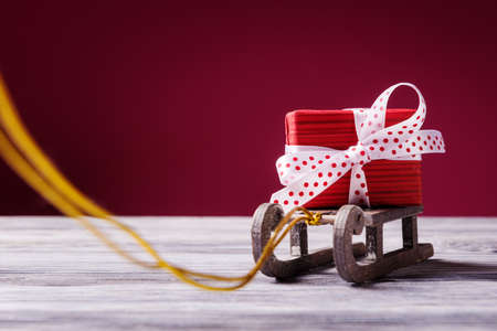 Santa's sleigh with red gift box. Christmas and New Year concept