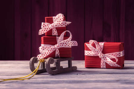 Red gift boxes on Santa's sleigh. New Year and Xmas greeting card
