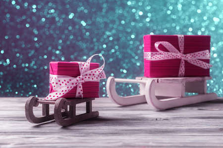 Red gift boxes on Santa's sleighs. New Year and Xmas card