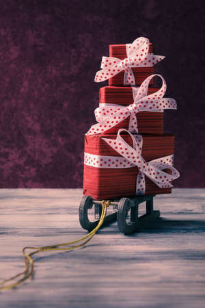 Pile of red gift boxes on Santa sleigh. Christmas and New Year greeting