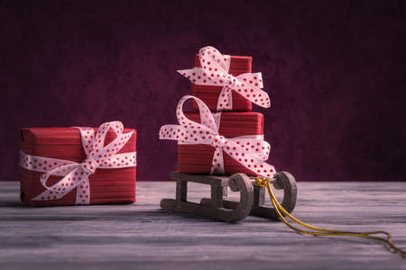 Red gift boxes on Santa's sleigh. New Year and Xmas greeting concept