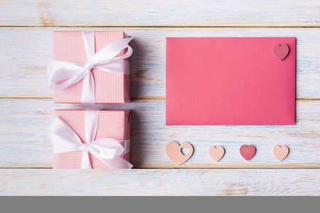 Gift boxes, decorative hearts and blank card with copy space. Valentine's day concept