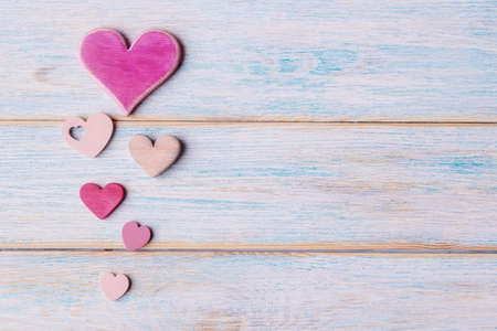 Various decorative hearts on old wooden background with copy space. Valentine's day concept