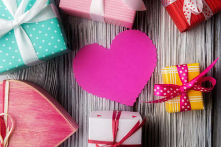 Heart shaped pink card and various gift boxes. Valentine's day concept
