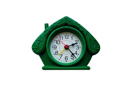 Desktop green clock in the form of a house