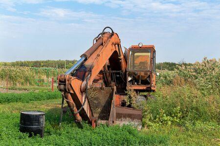 Abandoned broken old rusty excavator. Forgotten technics.