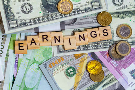 word text earnings on the money banknotes background