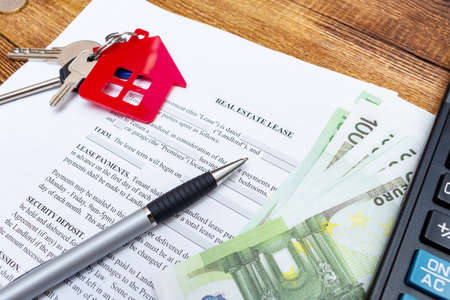 House, home, property, real estate lease rental contract agreement pen money coins keys wooden background, expenses, buying, investment, finance, savings, concept close up selective focus