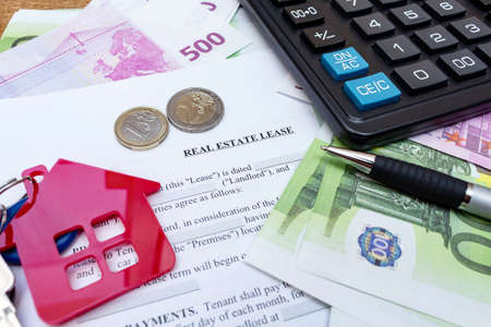 House, home, property, real estate lease rental contract agreement pen money coins keys wooden background, expenses, buying, investment, finance, savings, concept close up selective focus Standard-Bild