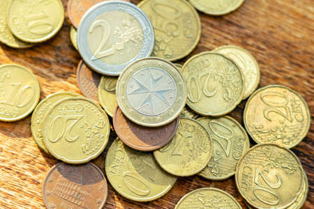 coins old rusty brass euro pile pack heap stack on a wooden background finance economy investment savings concept mock up selective focus close up
