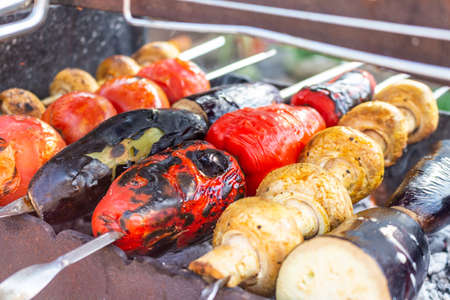 Vegetables on the grill cooking process barbecue, vegetarian food Reklamní fotografie