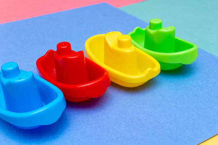 Plastic ships colorful child kid's education toys pattern background on the bright color background close up. Childhood education play infancy children baby concept