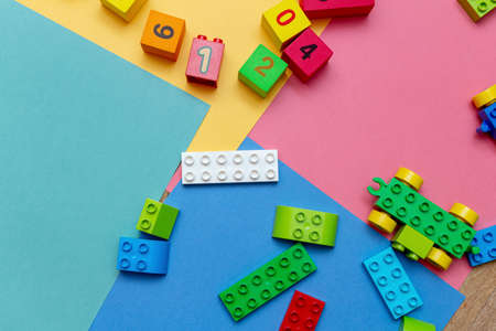 Colorful child kid's education toys constructor pattern background on the bright color background close up. Childhood education infancy children baby concept 免版税图像