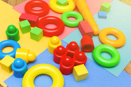 Colorful child kid's education toys constructor pattern background on the bright color background close up. Childhood education infancy children baby concept