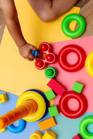 child kid playing colorful education toys pattern background on the bright background. Childhood infancy children babies concept. Banco de Imagens