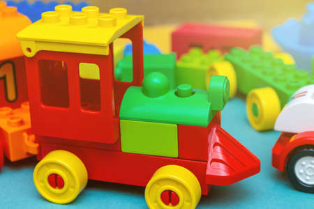 pack of colorful child kid's education toys constructor train pattern background on the bright color background close up. Childhood education play infancy children baby concept