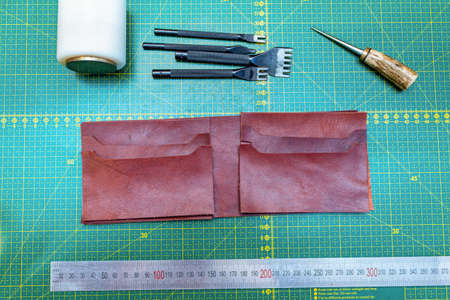 Creating sewing leather handmade wallet leathercraft. Pattern, tools, leather